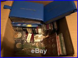 A Box of Coin Sets and Coins (some silver) from around the world See the list